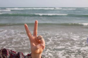 peace sign at the beach